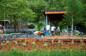 UW students put finishing touches on picnic shelter and plaza