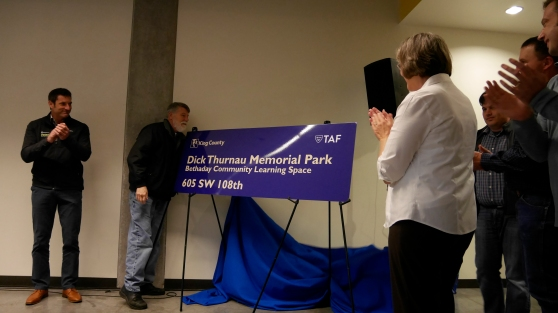 Thunau's family members unveiled the new park signs.