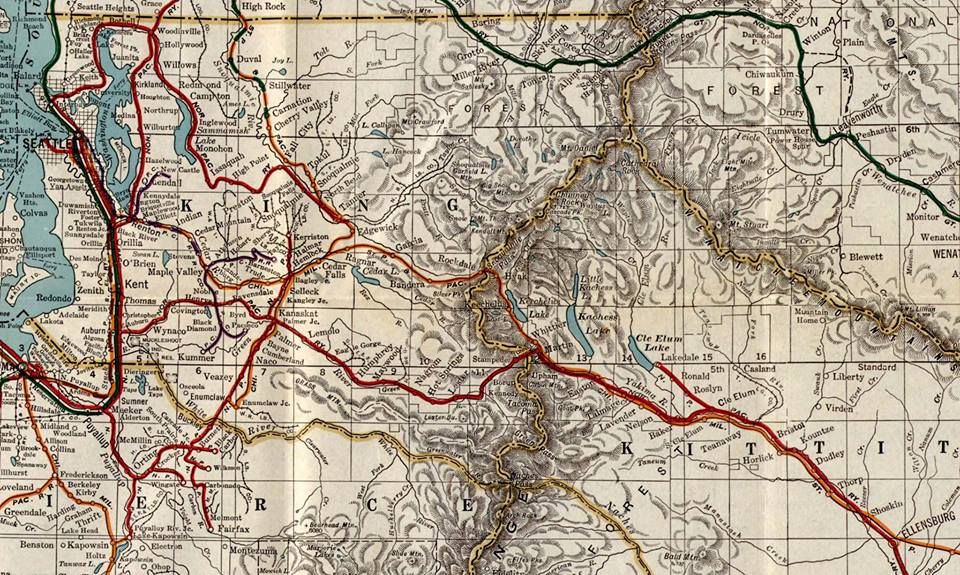 A historical map of King County showing colored lines crisscrossing representing rail lines.